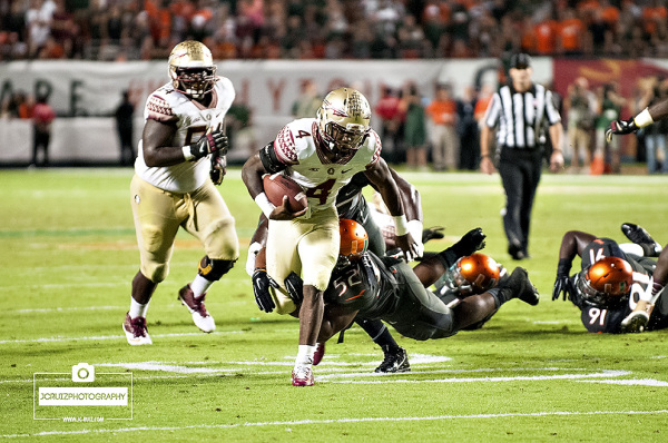 Florida State RB #4, Dalvin Cook, eludes the tackle of Miami LB #52, Denzel Perryman, for the game winning touchdown