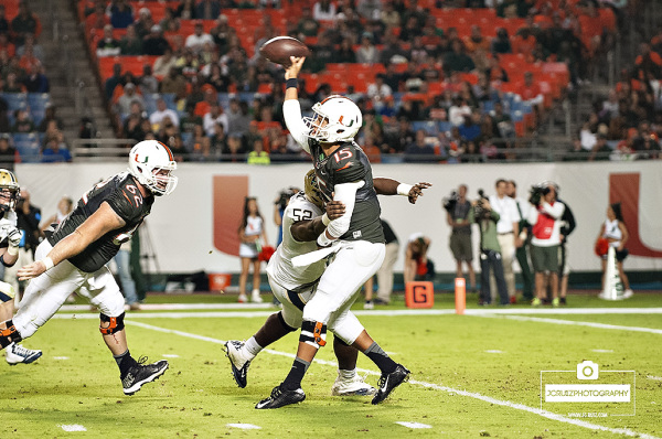 Brad Kaaya throws a pass under pressure