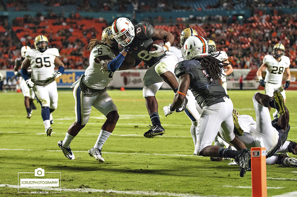 Duke Johnson leaps over defenders