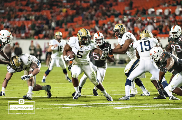 Chris James runs past the Hurricanes Defense