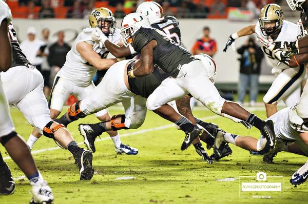 Duke Johnson rushes against Pitt