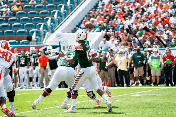 Hurricanes QB #15, Brad Kaaya, attempts a pass against Clemson
