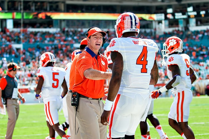Clemson head coach, Dabo Swinney, congratulates QB #4, Deshaun Watson, on his touchdown pass