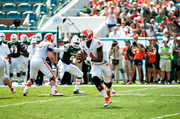 Clemson QB #4, Deshaun Watson, scrambles outside of the pocket against the Miami Hurricanes