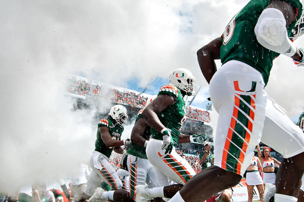Hurricane players emerge from the smoke