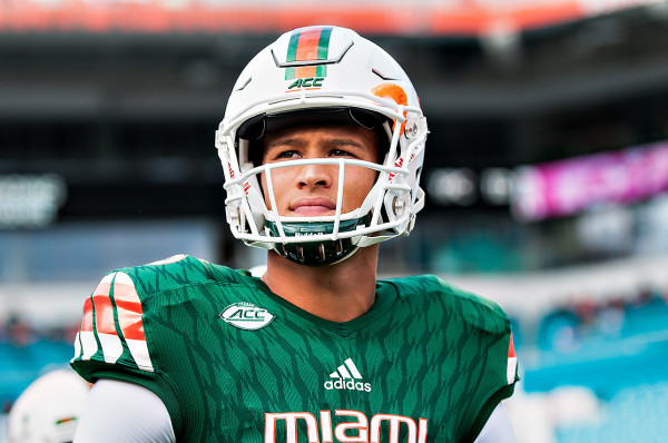 Miami Hurricanes QB #15, Brad Kaaya, looks out to the field as he walks to the coin toss