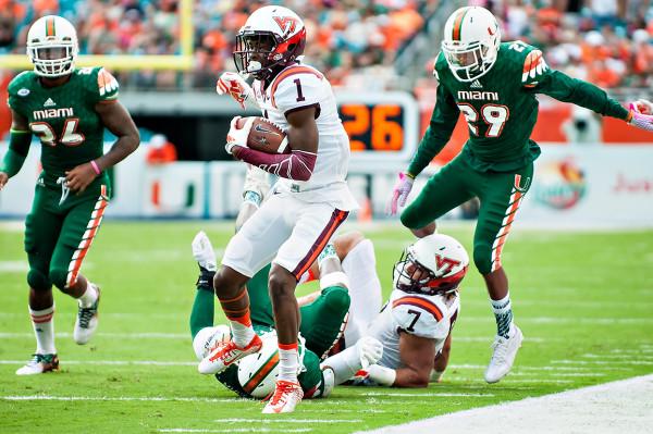 Virginia Tech WR #1, Isaiah Ford, runs after a catch