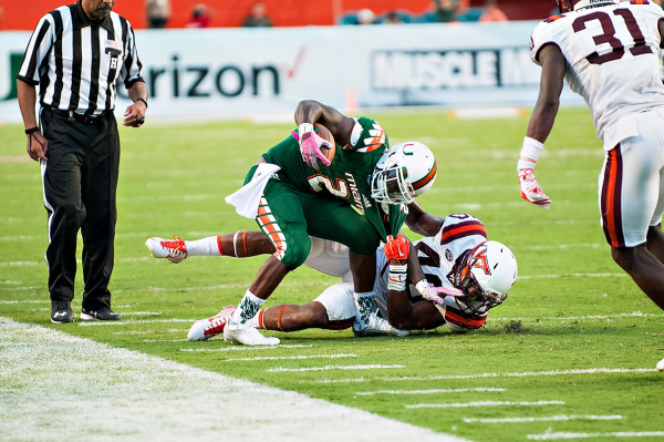 Miami Hurricanes RB #2, Joe Yearby, tries to escape the grasp of Virginia Tech LB #40, Deon Clarke