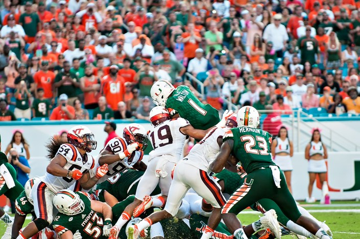 Miami Hurricanes RB #1, Mark Walton, tries to jump over the pile for a touchdown