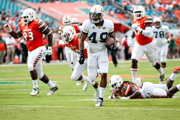 Georgia Tech running back, Clinton Lynch rushes against the Miami defense