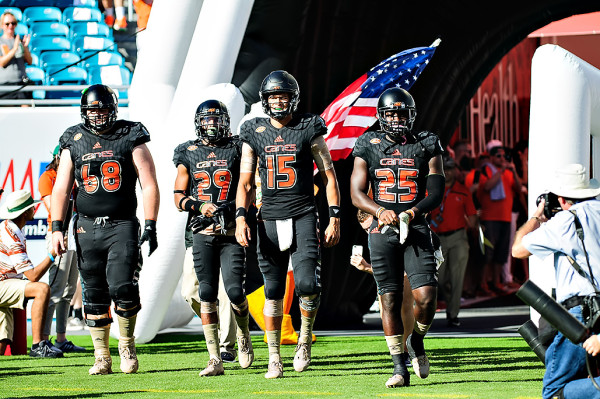 The Miami Hurricanes captains led by Brad Kaaya, walk out for the coin toss
