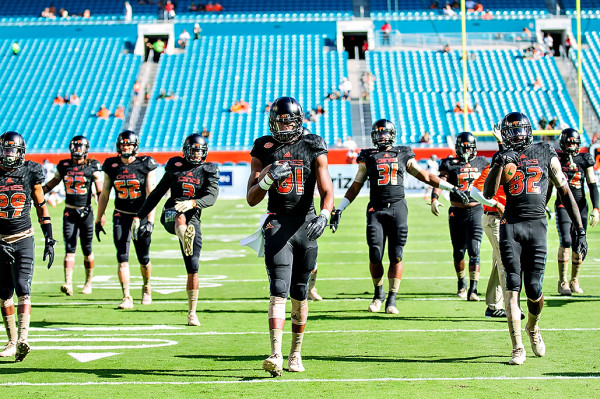 The Miami Hurricanes stretch before the game