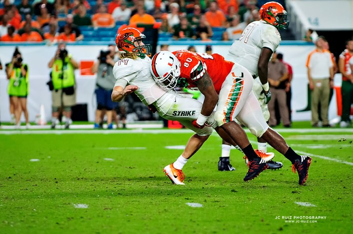 Hurricanes DL, RJ McIntosh, drives FAMU QB, Ryan Stanley, into the ground after a pass attempt