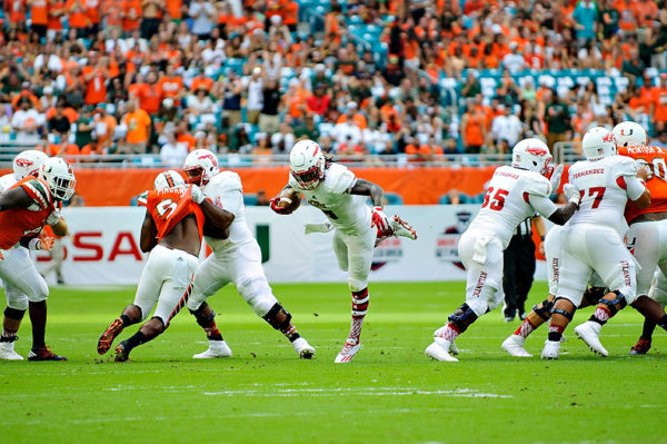 FAU RB, Gregory Howell, tries to spin through the hole