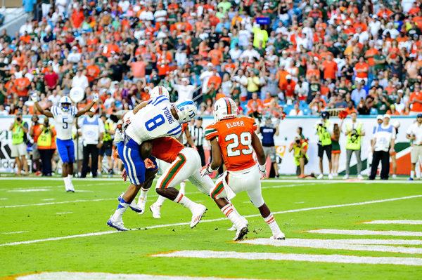 Hurricanes DB, Jamal Carter, hits Duke WR, Aaron Young, as he scores a touchdown
