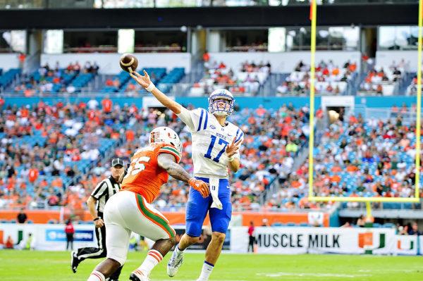 Duke QB, Daniel Jones, throws on the run