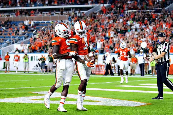 Malcolm Lewis congratulates Stacy Coley on his touchdown