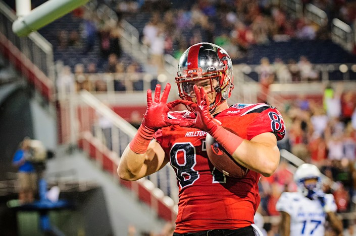WKU TE, Stevie Donatell, throws up a sign to celebrate a touchdown