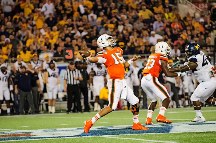 Miami Hurricanes QB, Brad Kaaya, launches a pass deep downfield