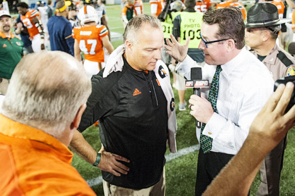 Mark Richt gives an interview to ESPN after the Hurricanes win