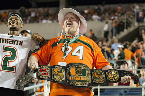 A Miami Hurricanes fan shows off his custom made championship belt