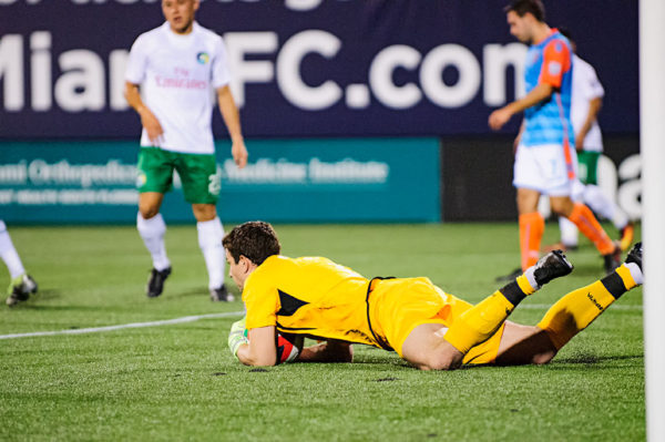 Goalie, Jimmy Maurer, collapses on the shot by Miami FC