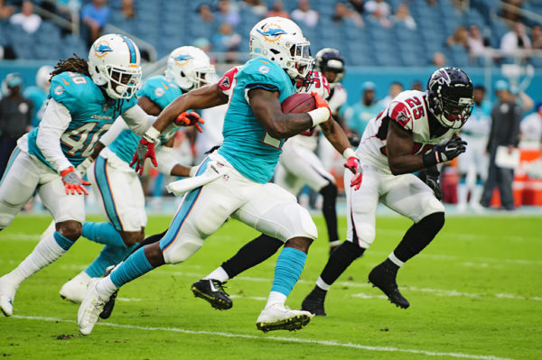 Dolphins KR, #27 Storm Johnson, runs a kickoff back against the Falcons