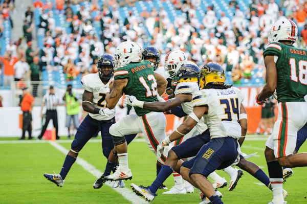 Malik Rosier breaks through defenders to find the endzone