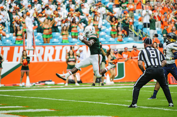 Mark Walton leaps into the endzone