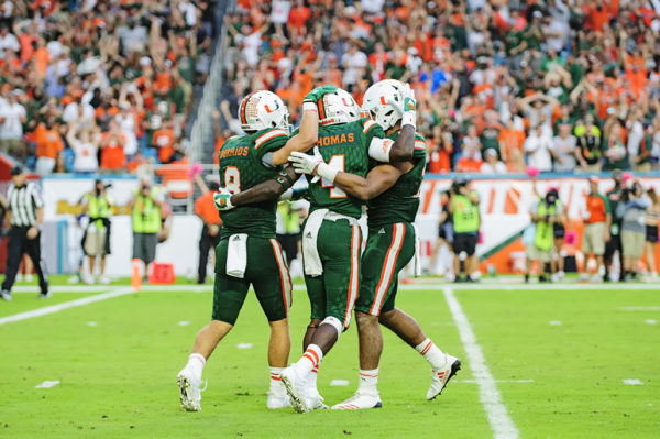 Jeff Thomas celebrates his touchdown with teammates