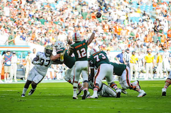 Malik Rosier throws a pass