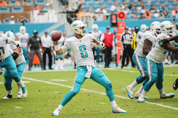 Matt Moore (8) looks to throw the ball