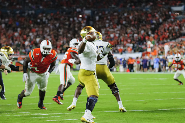 Brandon Wimbush (7) throws a pass from his own endzone