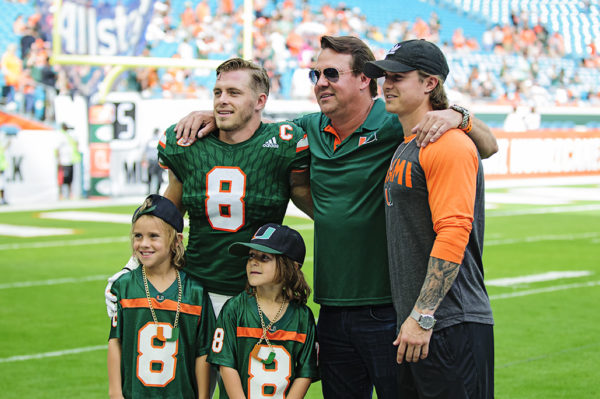 Braxton Berrios poses with family and friends on Senior Day