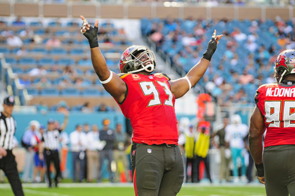 Gerald McCoy (93) celebrates his tackle