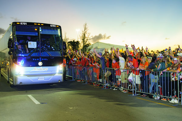 Miami Hurricane fans greet the Notre Dame team buses