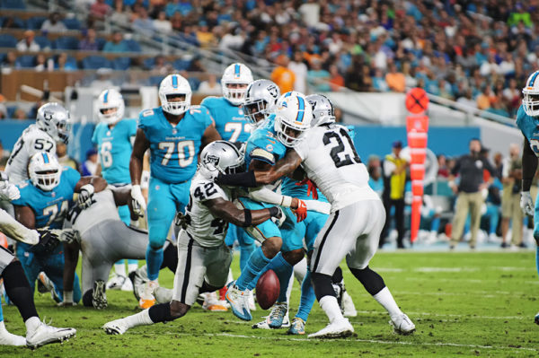 Kenyan Drake (32) fumbles the ball