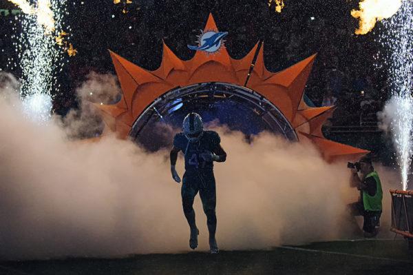 Kiko Alonso runs through the smoke and fire