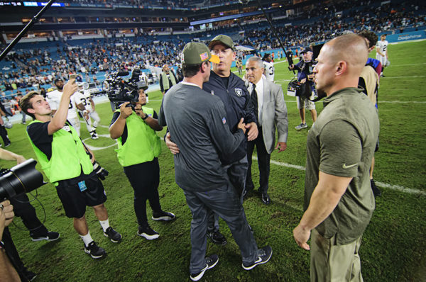 head coaches meet after the game