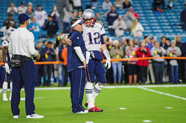 Tom Brady chats with Josh McDaniels during warmups