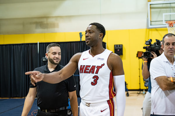 Dwyane Wade looks for media members to give out his Wade Wine to