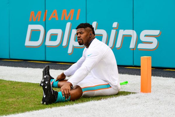 Miami Dolphins defensive end Cameron Wake (91) stretches prior to the game