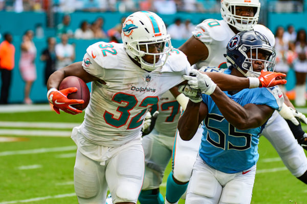 Miami Dolphins running back Kenyan Drake (32) with the stiff arm on Tennessee Titans linebacker Jayon Brown (55)