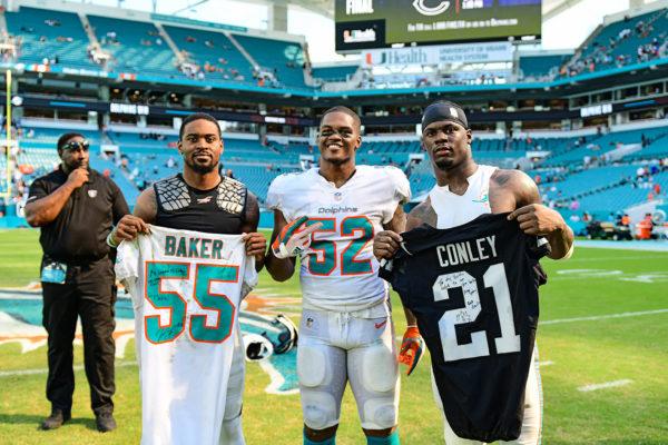 Miami Dolphins linebacker Jerome Baker (55), Miami Dolphins linebacker Raekwon McMillan (52) and Oakland Raiders cornerback Gareon Conley (21)