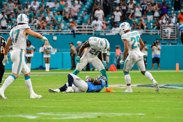 Miami Dolphins defensive back Reshad Jones (20) stares down Tennessee Titans running back Dion Lewis (33) after a tackle