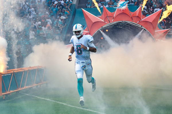Miami Dolphins quarterback Brock Osweiler (8) runs out of the tunnel