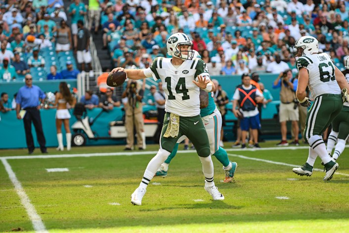 New York Jets quarterback Sam Darnold (14) throws on the run