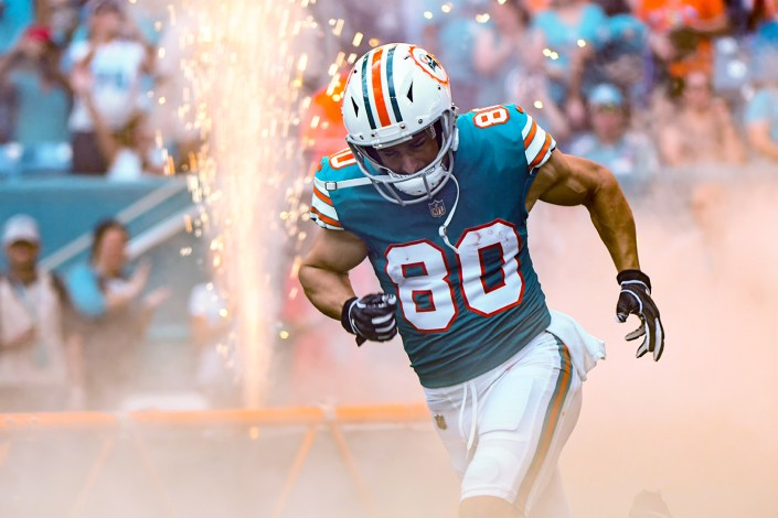 Miami Dolphins wide receiver Danny Amendola (80) runs through smoke
