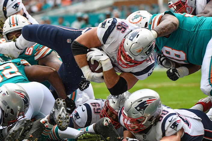 New England Patriots fullback James Develin (46) lunges in for the touchdown