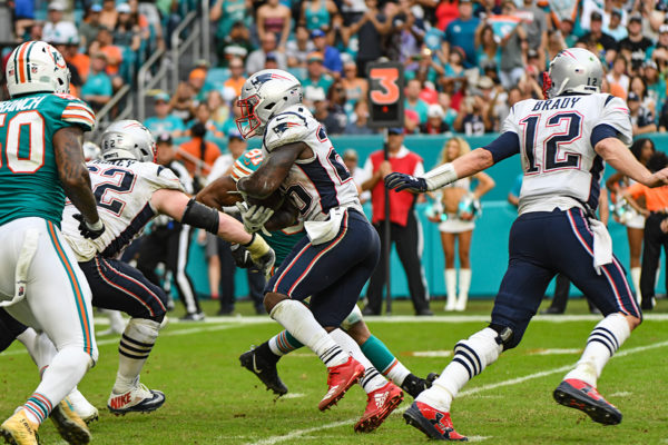 New England Patriots running back Sony Michel (26) takes the hand off from New England Patriots quarterback Tom Brady (12)